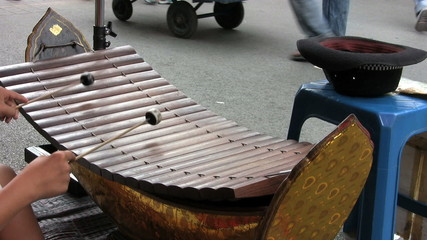 Asian Teen Playing A Wooden Xylophone