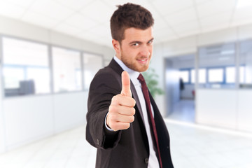Businessman showing ok gesture