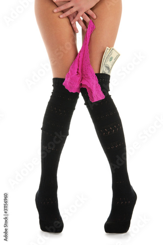 Female legs with Ruzicka and money isolated on white
