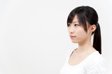 beautiful asian woman with ponytail style hair poster