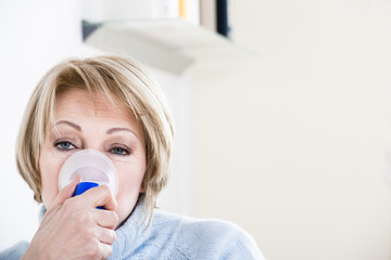 Woman Using A Nebulizer