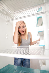 Teenager and empty fridge