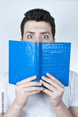 Afraid man reading a book