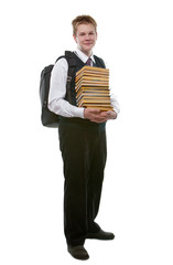 The schoolboy in a school uniform with a huge pack of books