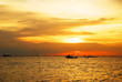 Seascape with fishing boat at sunset