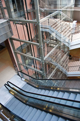 Glass lift shafts and escalators in a modern office building
