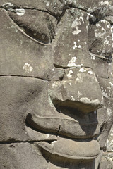 Stone head on towers of Bayon temple in Angkor Thom
