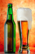 Bottle glass of beer on a yellow background