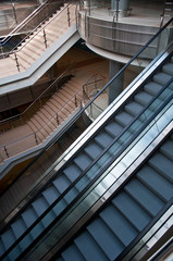 escalators and stairs in a modern office building