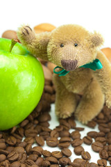 teddy bear with a bow,apple and  coffee beans
