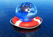 Earth globe in lifebuoy floating in water