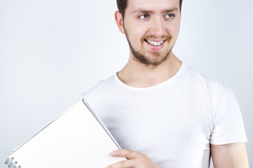 Blonde Male Holding a Notebook