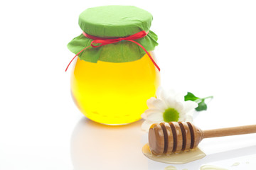 stick to hohey ,flower  and  jar of honey  isolated on white