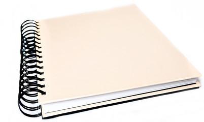 black pink spiral notebook over white