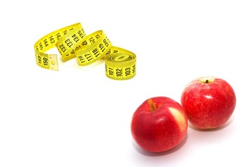 Measuring tape with red apples