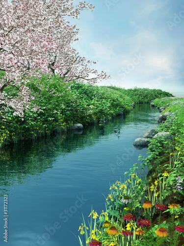 Panel Szklany Wiosenna sceneria z rzeką i kwitnącymi drzewami
