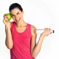 fitness girl with apple and bottle