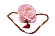 Rudraksha beads and a pink rose