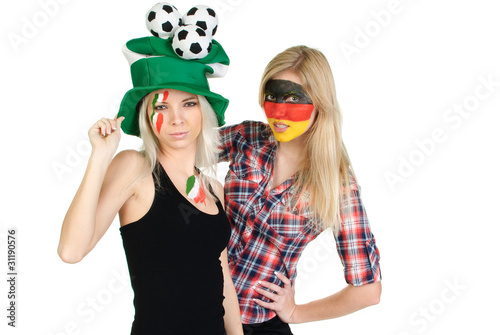 two sports fans with painted faces