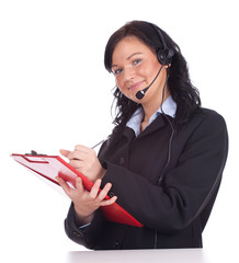 call center woman with a headset writing on clipboard