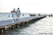 couple walking on long dock
