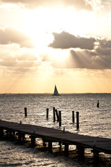 sunset in paradise sailboat