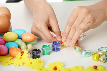 Young girl is making easter decoration