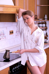 Beautiful young woman make coffee in the kitchen