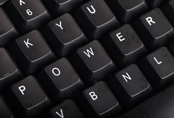 The word power written on a keyboard