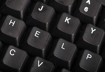 The word help written on a keyboard