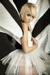 Amazing blonde girl in beautiful dress