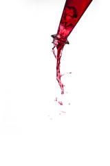 rote Flüssigkeit fließt aus einer Flasche #2