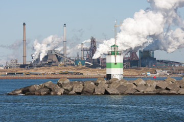 Steel factory with harbor at the Dutch coast