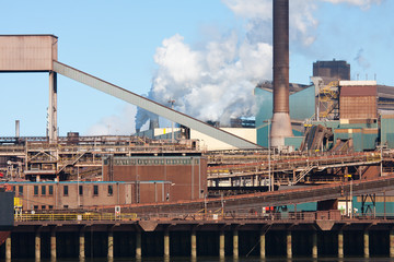 Steel factory with smokestack