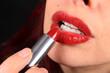 Applying lipstick to luscious lips