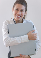 student hugs her laptop