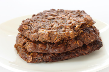 Brown oatmeal cookies on plate