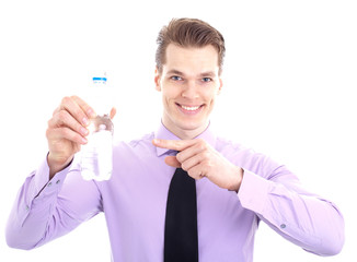 Businessman showing bottle of water, smiling