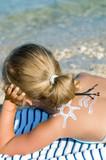 Little girl enjoying the sun poster