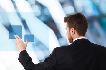Businessman using touchscreen