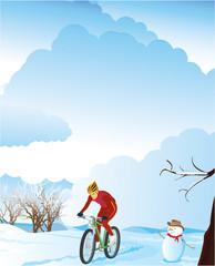Winter landscape with a mountain biker.