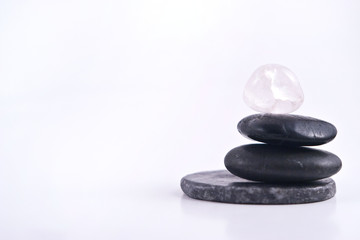 Stack of Balanced Zen Rocks with a White Background