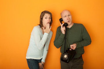 Shocked Woman Listening To Telephone Conversation