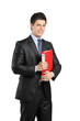 Smiling businessperson holding a red folder with documents