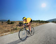 Cyclist riding a bike on an open road in Macedonia