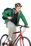 A young bicyclist on a bicycle posing poster