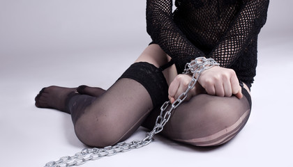 girl sit with chain on hands - bdsm games