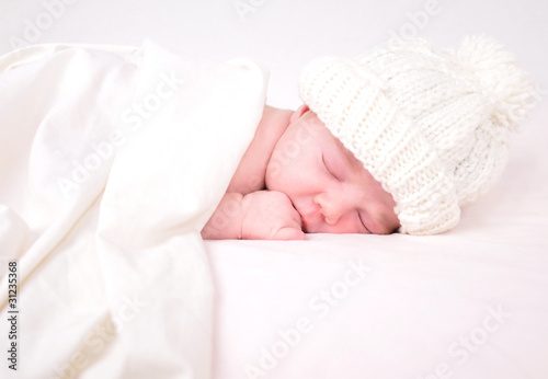 Little Newborn Baby Sleeping on White with Blanket