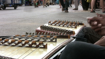 Playing The Khim-Thai Instrument