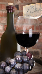 Glass and a bottle of wine to stand near a brick wall. In the ol